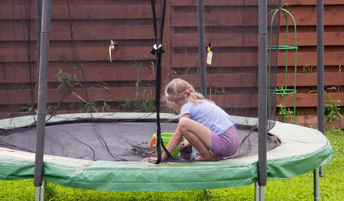 kid on trampoline