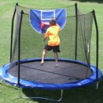 jump n dunk - child playing b-ball on trampoline